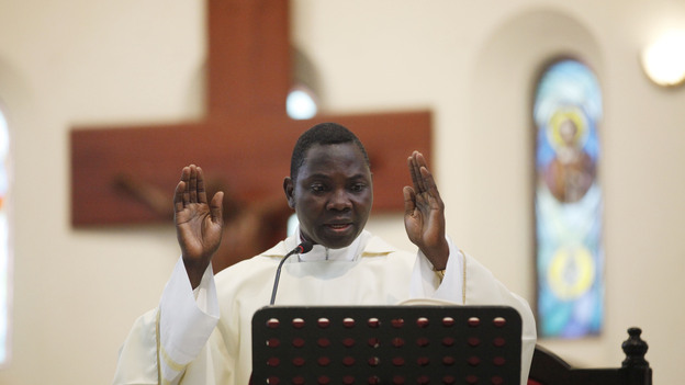Priest Anthony Obanla says Mass at a church in Lagos, Nigeria. In Africa, where the Catholic Church continues to grow, worshipers and clergy hope to see one of their own rise to lead the faithful. (AP)