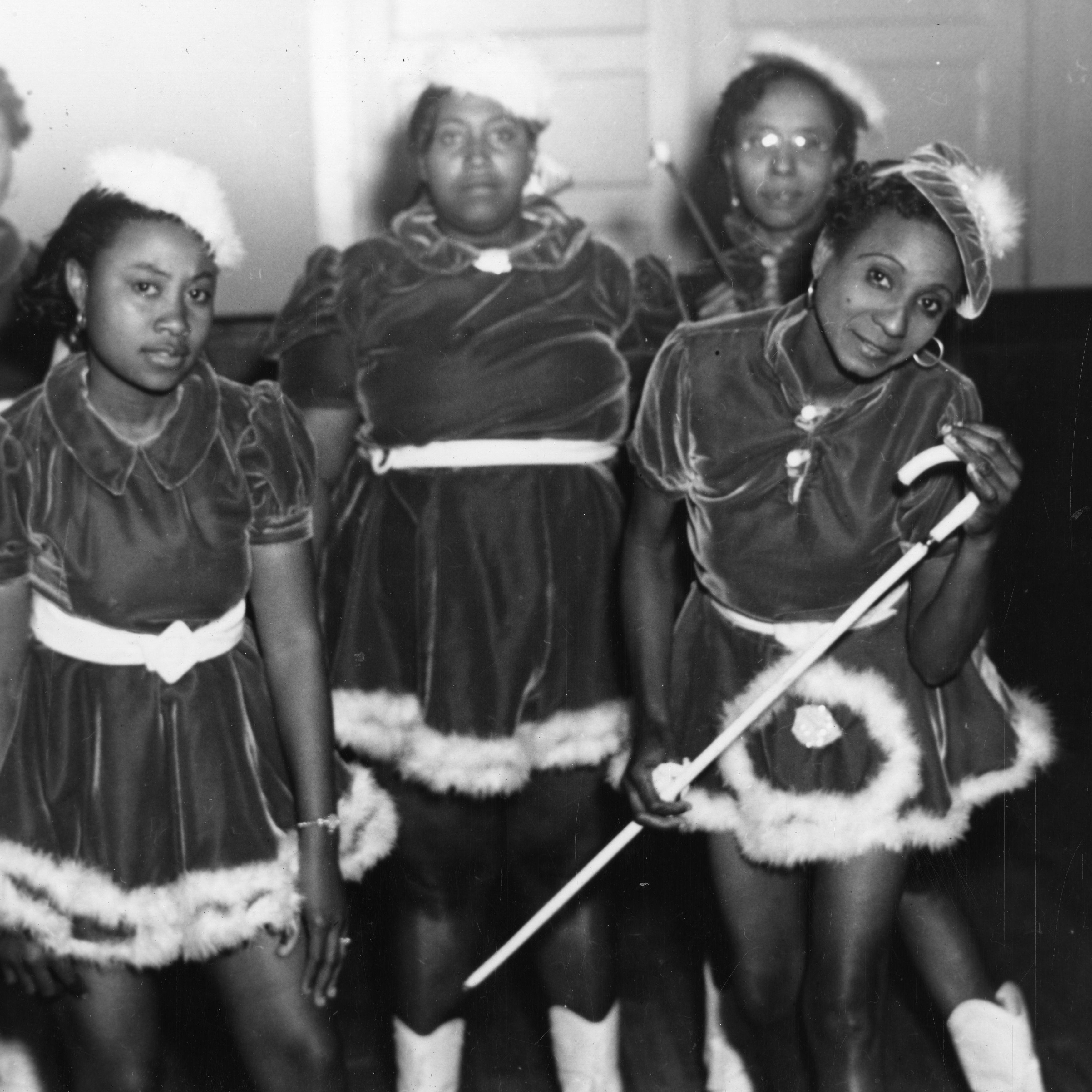"This 1942 photo provided by the Louisiana State Museum shows Gold Digger Baby Dolls, one of the neighborhood groups that adopted the ""baby doll"" costumes."