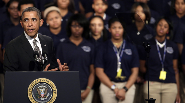 President Obama speaks about strengthening the middle class and the nation's struggle with gun violence at Hyde Park Academy in Chicago on Friday. (AP)