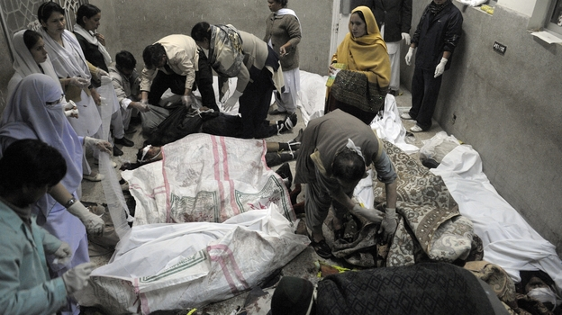 Rescue teams attend the bodies of victims who died in a marketplace bomb blast in Quetta, Pakistan, on Saturday. (AFP/Getty)