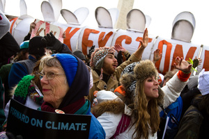 """Protestors chant """"Shift the Power"""" during the Forward on Climate Rally"""