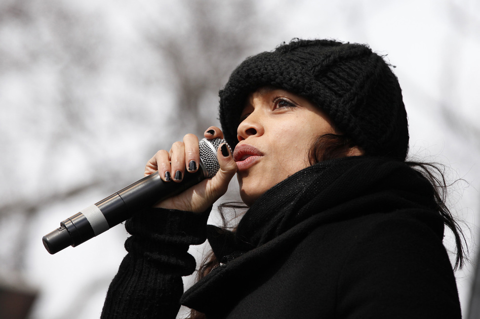 Actress Rosario Dawson addresses the crowd at the Forward on Climate Rally, before marching in solidarity with activists from the Indigenous Environmental Network (NPR)