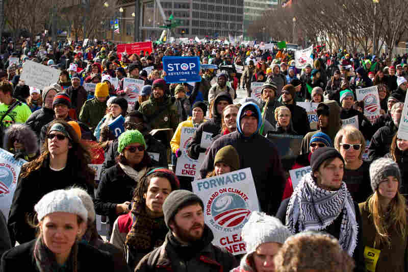 Marchers filled Pennsylvania Avenue directly in front of the White House, with many participants stopping to chant slogans and take pictures beside the fence.