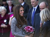 The Duchess of Cambridge receives a bouquet of flowers, as she leaves after a visit to Hope House in London on Tuesday. The former Kate Middleton appeared unaffected by the controversy surrounding remarks made by author Hilary Mantel.