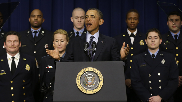 President Obama, accompanied by emergency responders — workers the White House says could be affected if state and local governments lose federal money as a result of budget cuts — speaks in the Eisenhower Executive Office building in Washington on Tuesday. (AP)