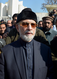 Qadri leaves the Supreme Court building after submitting a petition in Islamabad earlier this month.
