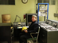 WBT chief engineer Jerry Dowd sits at the shelter's console. All of the bunker's communications equipment is still functional.