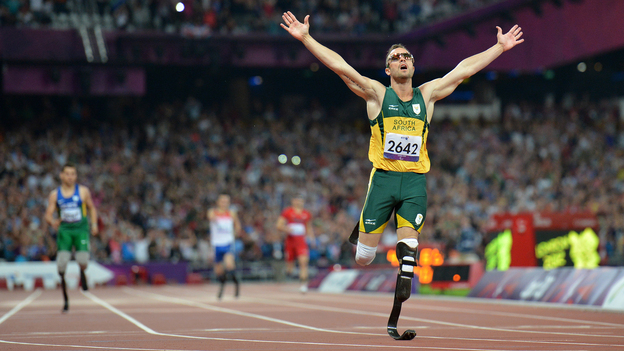 Oscar Pistorius, seen here winning a gold medal at the London 2012 Paralympic Games, faces charges that he murdered his girlfriend. Pistorius also competed in the 2012 Summer Olympics. (AFP/Getty Images)