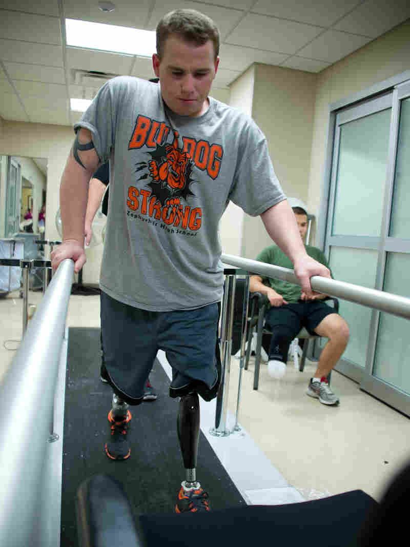 Jeffries takes his first steps on prosthetic legs during what he described as an exhausting and painful physical therapy session at Walter Reed National Military Medical Center in Bethesda, Md., in November 2012, less than two months after the roadside bombing.