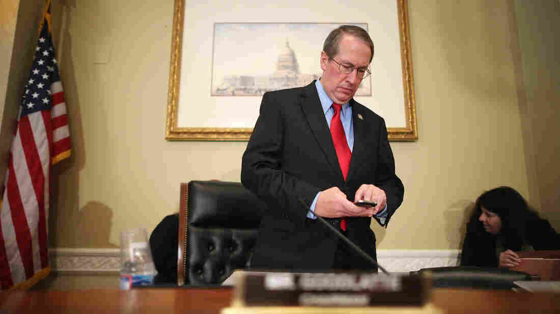 Rep. Bob Goodlatte, R-Va., checks his phone before a hearing on Capitol Hill in September.