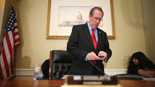 Rep. Bob Goodlatte, R-Va., checks his phone before a hearing on Capitol Hill in September. (Getty Images)