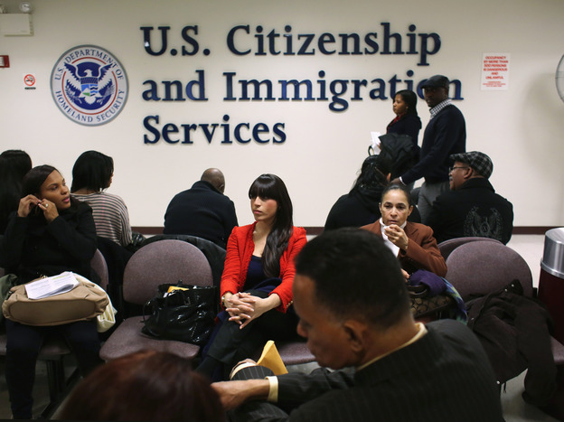 Immigrants wait for their citizenship interviews at the U.S. Citizenship and Immigration Services on Jan. 29.