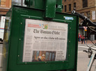 A Boston Globe newpaper sits inside a vendor box in 2009.