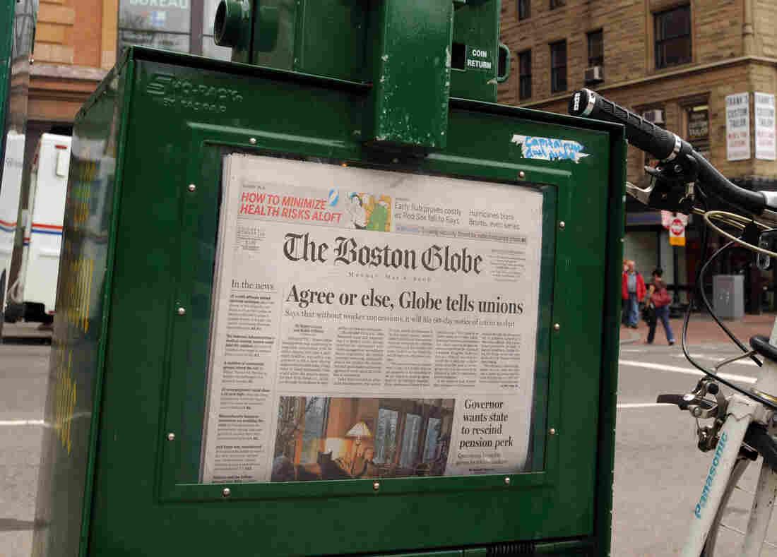A Boston Globe newpaper sits inside a vendor box in 2009.
