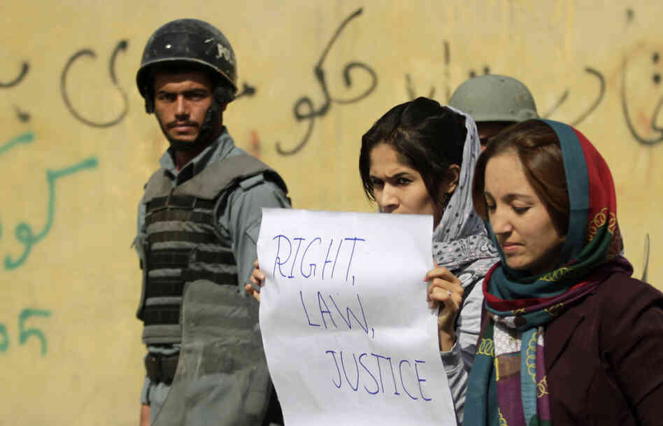Students in Kabul protest violence against women in Kabul last fall. Afghan President Hamid Karzai issued a decree in 2009 protecting women's rights
