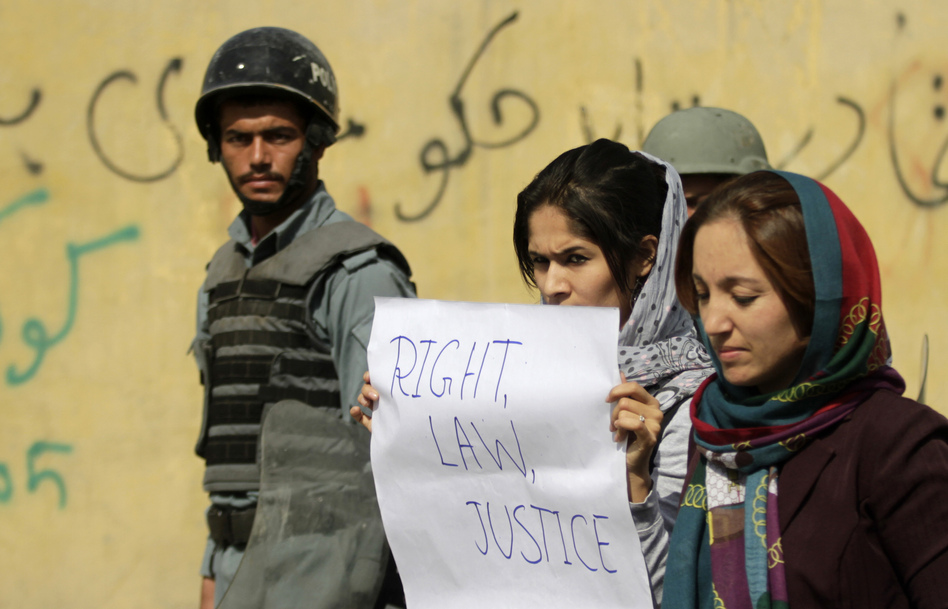 Students in Kabul protest violence against women in Kabul last fall. Afghan President Hamid Karzai issued a decree in 2009 protecting women's rights, but parliament has not passed a law making the decree permanent. (Mohammad Ismail/Reuters/Landov)