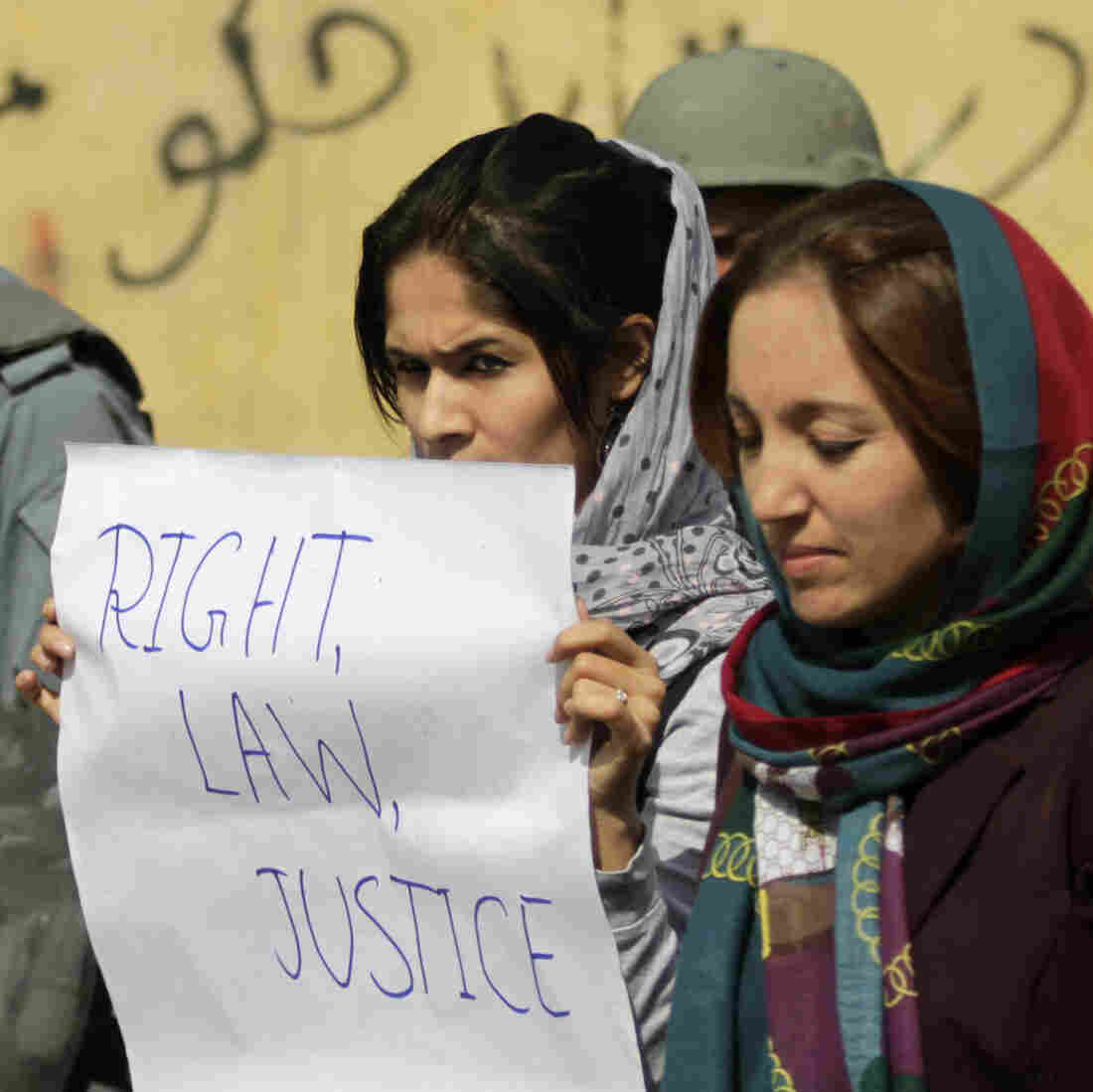 Students in Kabul protest violence against women in Kabul last fall. Afghan President Hamid Karzai issued a decree in 2009 protecting women's rights, but parliament has not passed a law making the decree permanent.