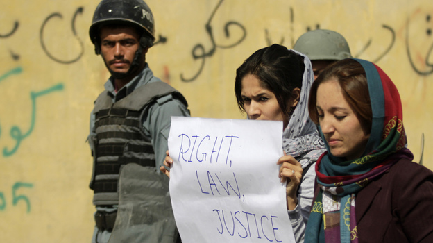 Students in Kabul protest violence against women in Kabul last fall. Afghan President Hamid Karzai issued a decree in 2009 protecting women's rights, but parliament has not passed a law making the decree permanent. (Reuters/Landov)