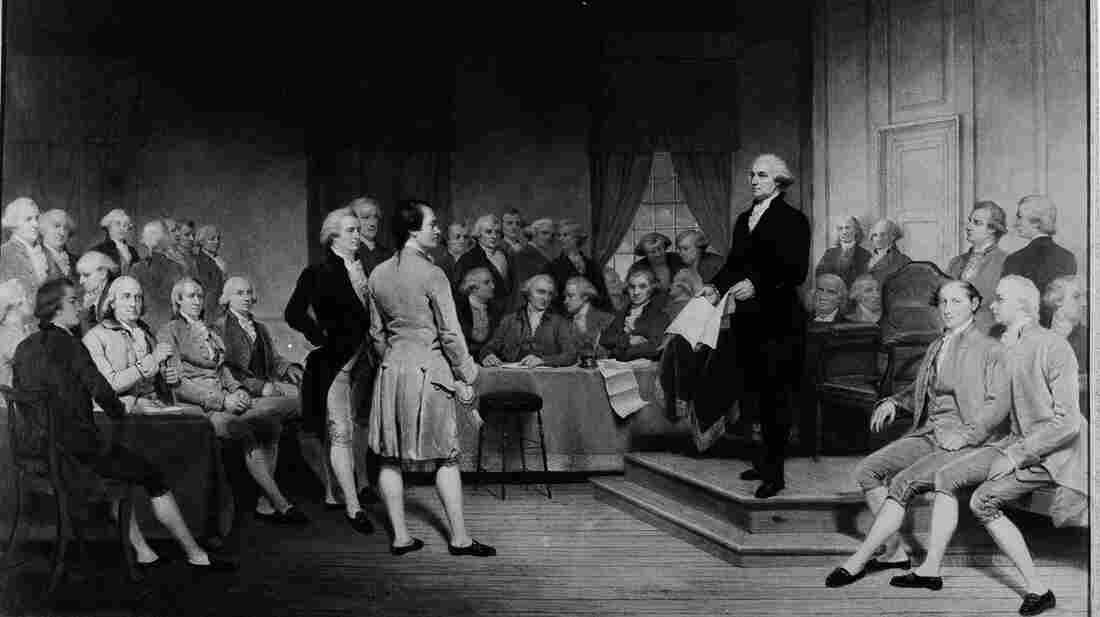 George Washington is depicted addressing the Constitutional Convention of 1787 in this painting by Junius Brutus Stearns. Presumably, no representative from Rhode Island is in the picture; Rhode Island boycotted the gathering and originally rejected the Constitution.