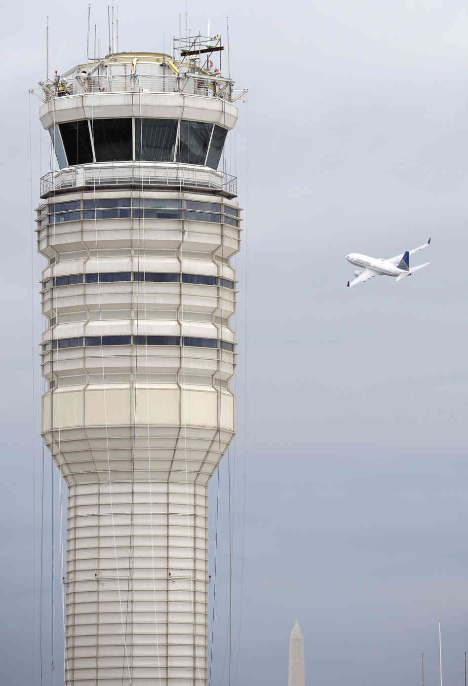 A passenger jet flies past the FAA c