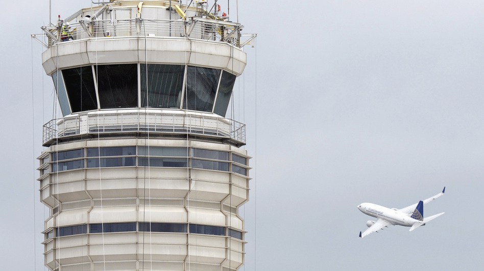A passenger jet flies past the FAA control tower at Washington's Ronald Reagan National Airport in 2011. (AP)