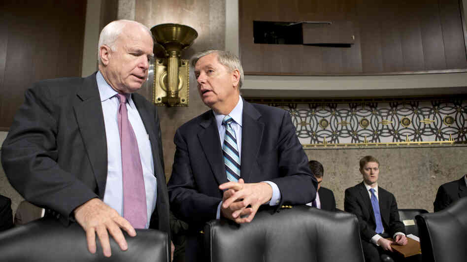 Sens. John McCain, R-Ariz., and Lindsey Graham, R-S.C., confer at the start of a Senate Ar