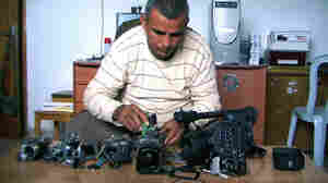 Emad Burnat, a Palestinian who co-directed the Oscar-nominated documentary 5 Broken Cameras, displays the cameras destroyed by Israeli settlers and security forces. The film focuses on a Palestinian village protesting Israel's separation barrier in the West Bank.