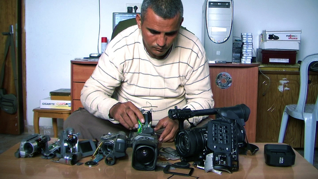 Emad Burnat, a Palestinian who co-directed the Oscar-nominated documentary 5 Broken Cameras, displays the cameras destroyed by Israeli settlers and security forces. The film focuses on a Palestinian village protesting Israel's separation barrier in the West Bank. (AP)