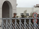 A Chinese soldier stands guard Tuesday in front of the Shanghai building that houses military Unit 61398. A U.S. cybersecurity company says the unit is behind nearly 150 computer attacks on U.S. and other Western companies and organizations in recent years. China denies the allegation.