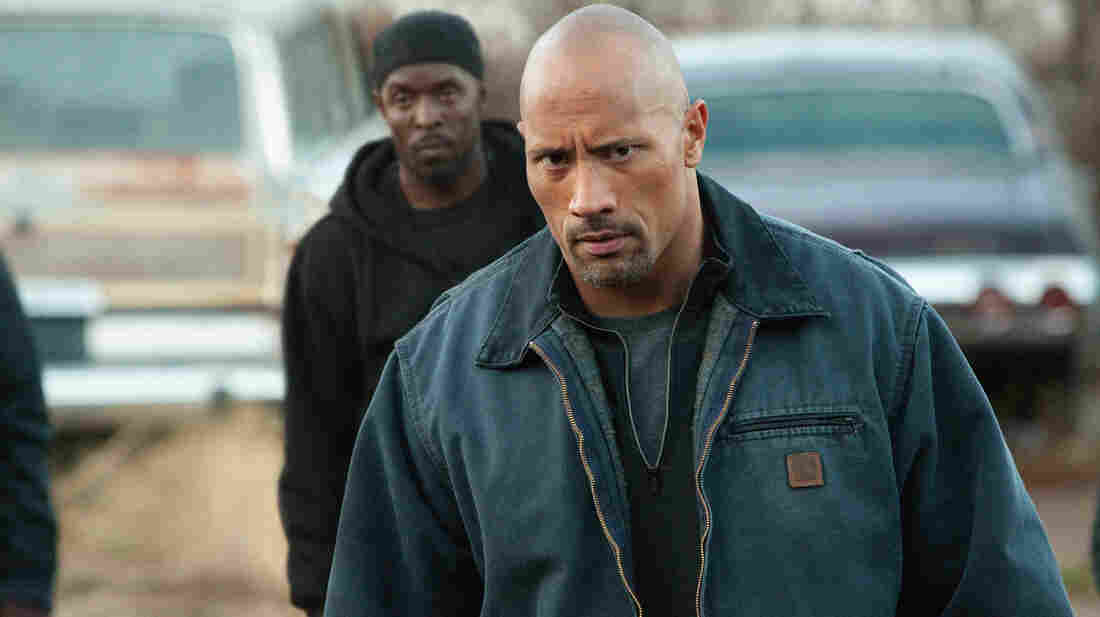 """As hard-hitting father John, Dwayne """"The Rock"""" Johnson, goes deep undercover to save his son from stern drug-crime laws."""