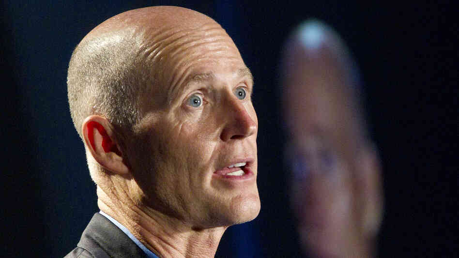 Florida Gov. Rick Scott, long a foe of the administration's health overhaul, reversed course an