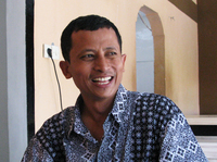 Convicted ex-terrorist Mahmudi Haryono recounts his experiences while sitting at a table at the restaurant where he works in Semarang, Indonesia. The restaurant is one of three founded by social entrepreneur and reformed radical Noor Huda Ismail, to help ex-jihadis in Indonesia reintegrate into society.