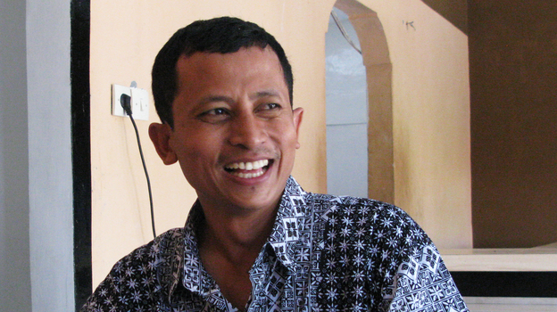 Convicted ex-terrorist Mahmudi Haryono recounts his experiences while sitting at a table at the restaurant where he works in Semarang, Indonesia. The restaurant is one of three founded by social entrepreneur and reformed radical Noor Huda Ismail, to help ex-jihadis in Indonesia reintegrate into society. (NPR)