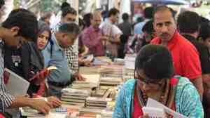 Attendees browse books on offer at the fourth annual Karachi Literature Festival.