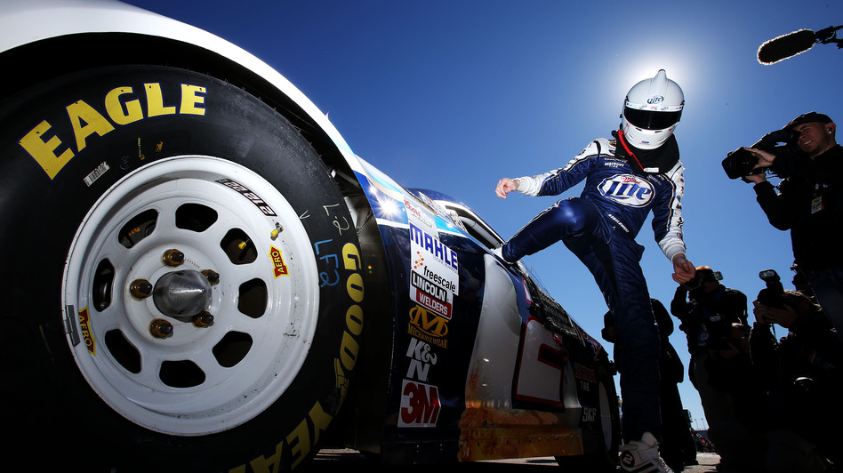 Brad Keselowski, driver of the #2 Miller Lite Ford, gets out of his car after qualifying for the NASCAR Sprint Cup Series Daytona on Feb. 17. (Getty Images)