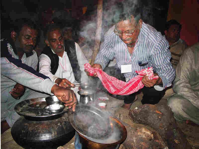 Followers of Kamal prepare tea during the Kumbh Mela.
