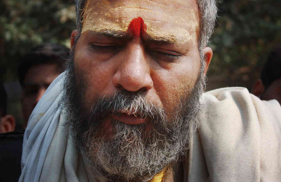Gyanesh Kamal, a Hindu saint, attends the Kumbh Mela on the banks of the Ganges River in the northern Indian city of Allahabad. The gathering is the largest religious festival in the world.