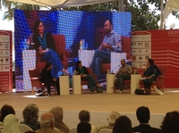 Novelists Nadeem Aslam, Kamila Shamsie, Mohsin Hamid on stage at the Karachi Literature Festival. On the far right is the moderator, writer Muneeza Shamsie — Kamila Shamsie's mother.