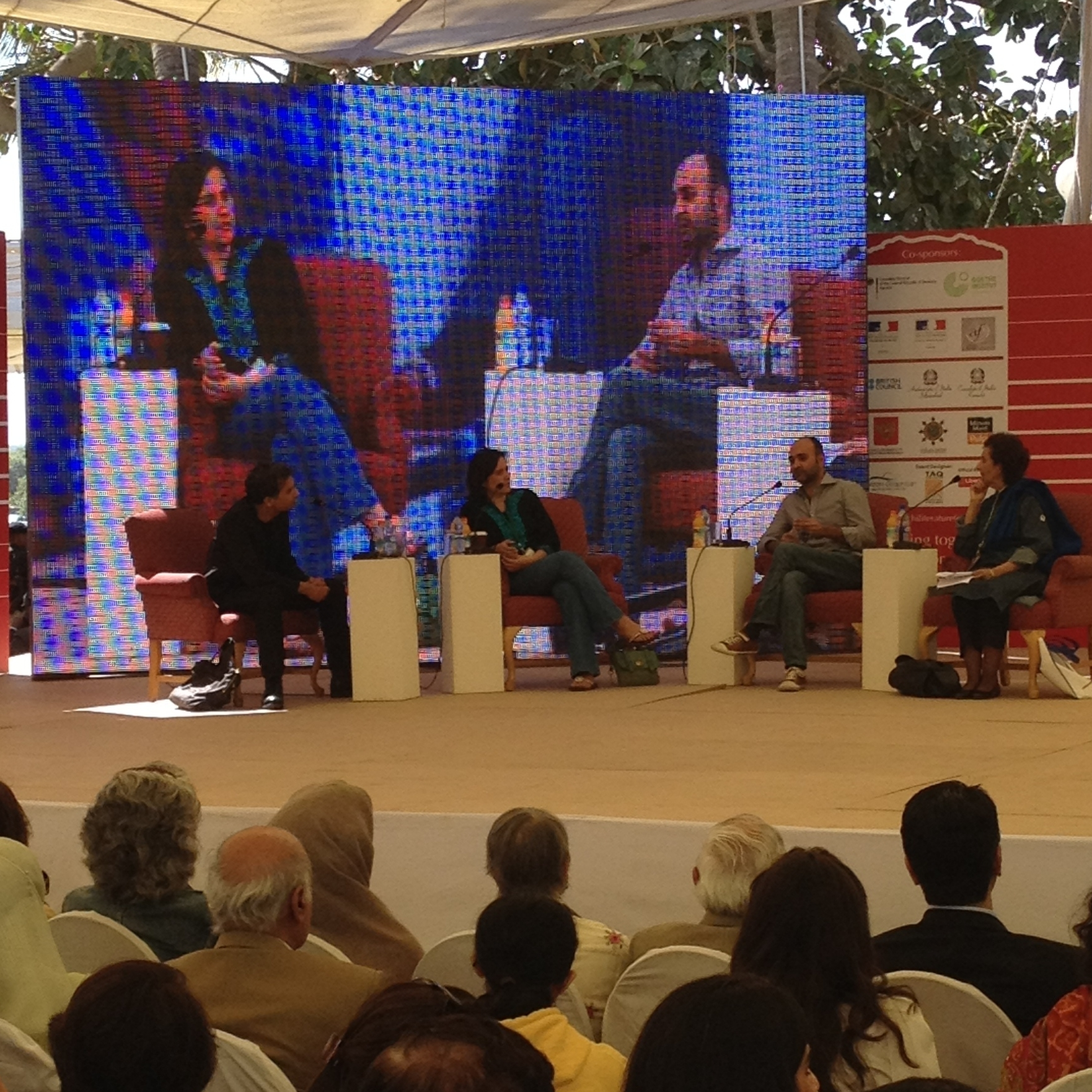 Novelists Nadeem Aslam, Kamila Shamsie, Mohsin Hamid on stage at the Karachi Literature Festival. On the far right is the moderator, writer Muneeza Shamsie -- Kamila Shamsie's mother.