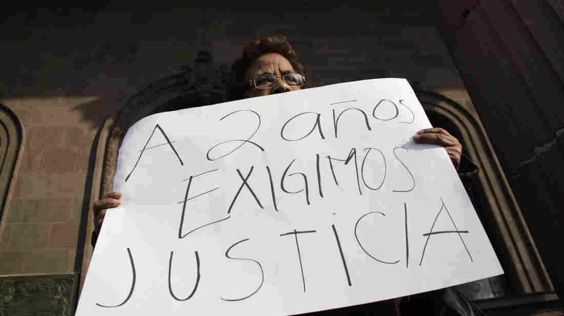 "A woman holds a sign that reads, ""We demand justice after two years,"" during a Jan. 11 protest outside the government palace in Monterrey denouncing the disappearance of family members in the state of Nuevo Leon."