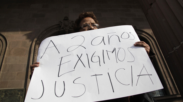 "A woman holds a sign that reads, ""We demand justice after two years,"" during a Jan. 11 protest outside the government palace in Monterrey denouncing the disappearance of family members in the state of Nuevo Leon. (Reuters/Landov)"