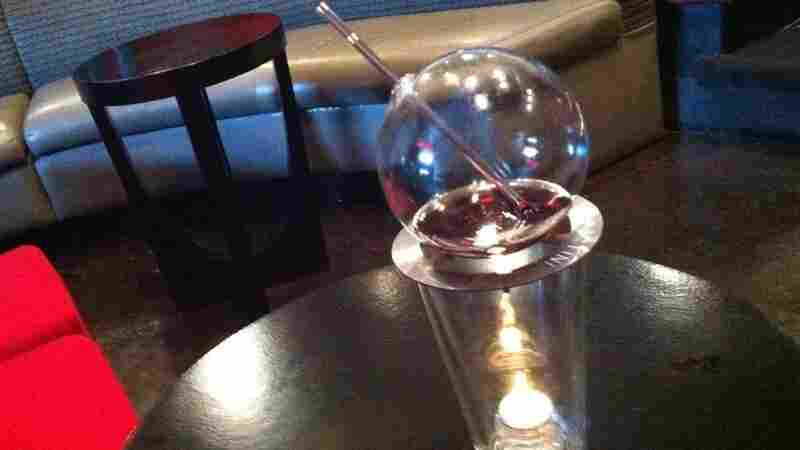 To mix up a Vaportini, add your favorite spirit to the glass globe and light the candle below. A few minutes later, vapors fill the glass with flavors and alcohol.