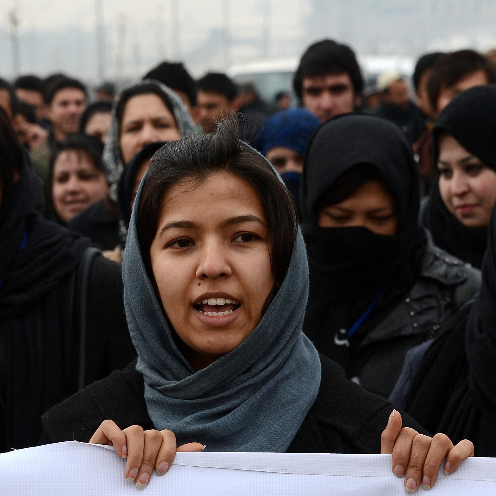 Afghan women march during a protest calling for an end to violence against women in Afghanistan and around the world, in Kabul, on Feb. 14. Since 2009, Afghan parliamentarians have failed to make permanent a presidential decree protecting women's rights.
