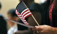 Newly sworn-in U.S. citizens recite the Pledge of Allegiance during a naturalization ceremony in Baltimore in 2012.