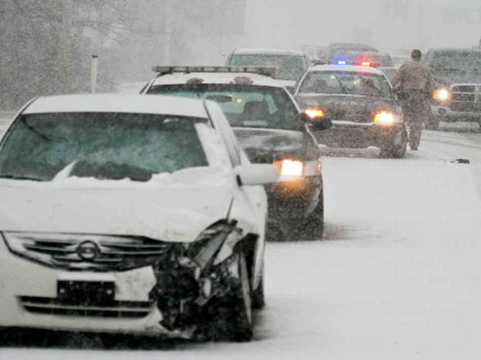 Snow-packed morning commute in Wichita on Wednesday.