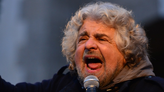 Comedian-turned-politician Beppe Grillo addresses supporters at a rally on Feb. 12 in Bergamo, Italy. Many pollsters say his populist Five Star Movement could come in third in this weekend's election. (AFP/Getty Images)