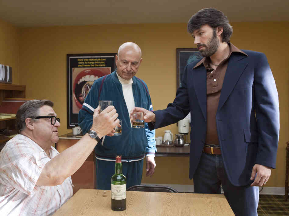 John Goodman, Alan Arkin and actor-director Ben Affleck in Argo.