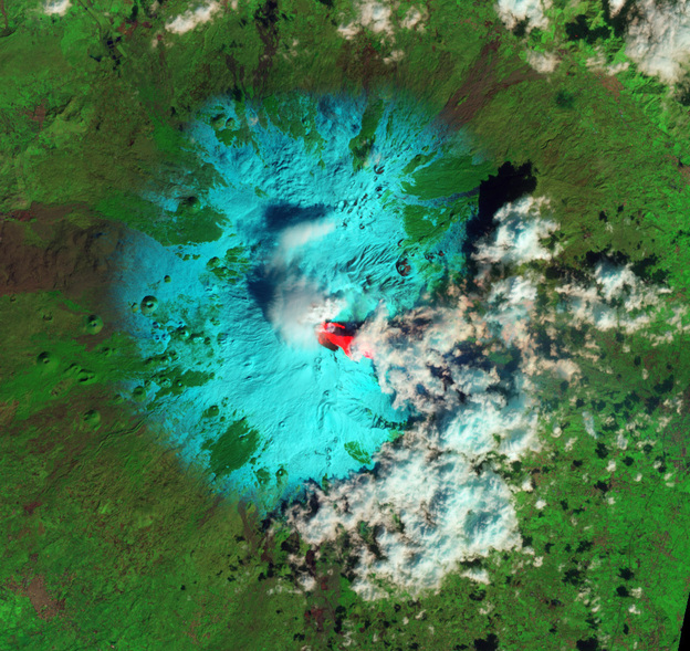 Sicily's Mount Etna early this week, as seen from space. The bright red is lava. Snow is blue-green. Clouds are white.