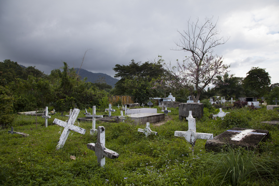A view of a cemetery in Sambo Creek. Before medicines were made widely available in the early 2000s, scores of people in the Garifuna community died from AIDS. According to local NGOs, the death rate has dropped dramatically. (Pulitzer Center)