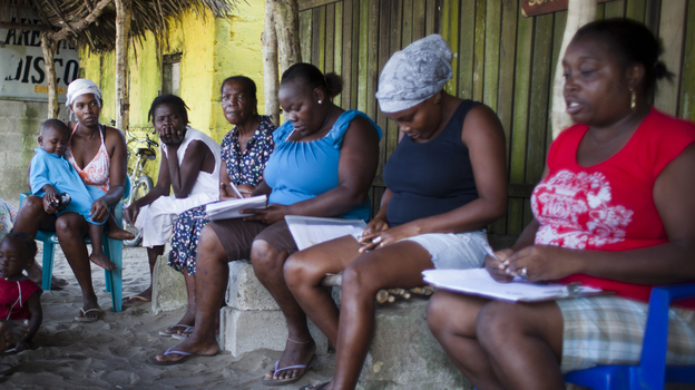 Women meet during a support group for those who have HIV and their friends and family on Jan. 17 in Triunfo de la Cruz. These kinds of support groups are an important part of making people feel comfortable with their diagnosis and seeking treatment. (Pulitzer Center)